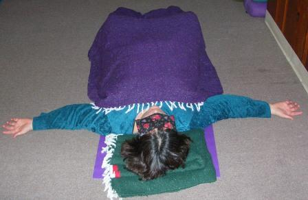 savasana aka corpse pose  barefoot and upside down